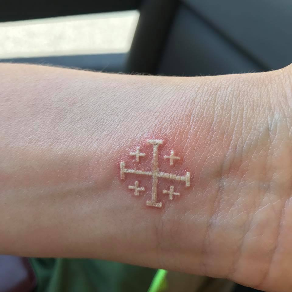 Jerusalem Cross tattoo in white ink.